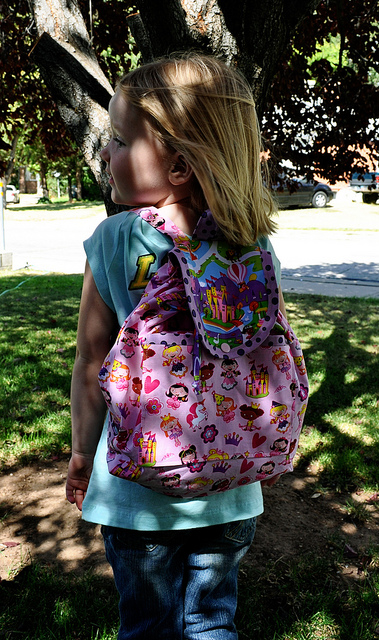 Maria sews backpack